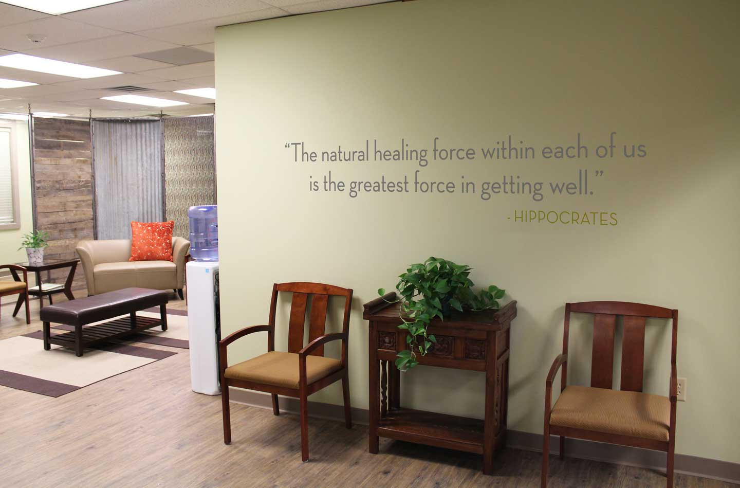 "Wall sign that reads: The natural healing force within each of us is the greatest force in getting well."" - Hippocrates"